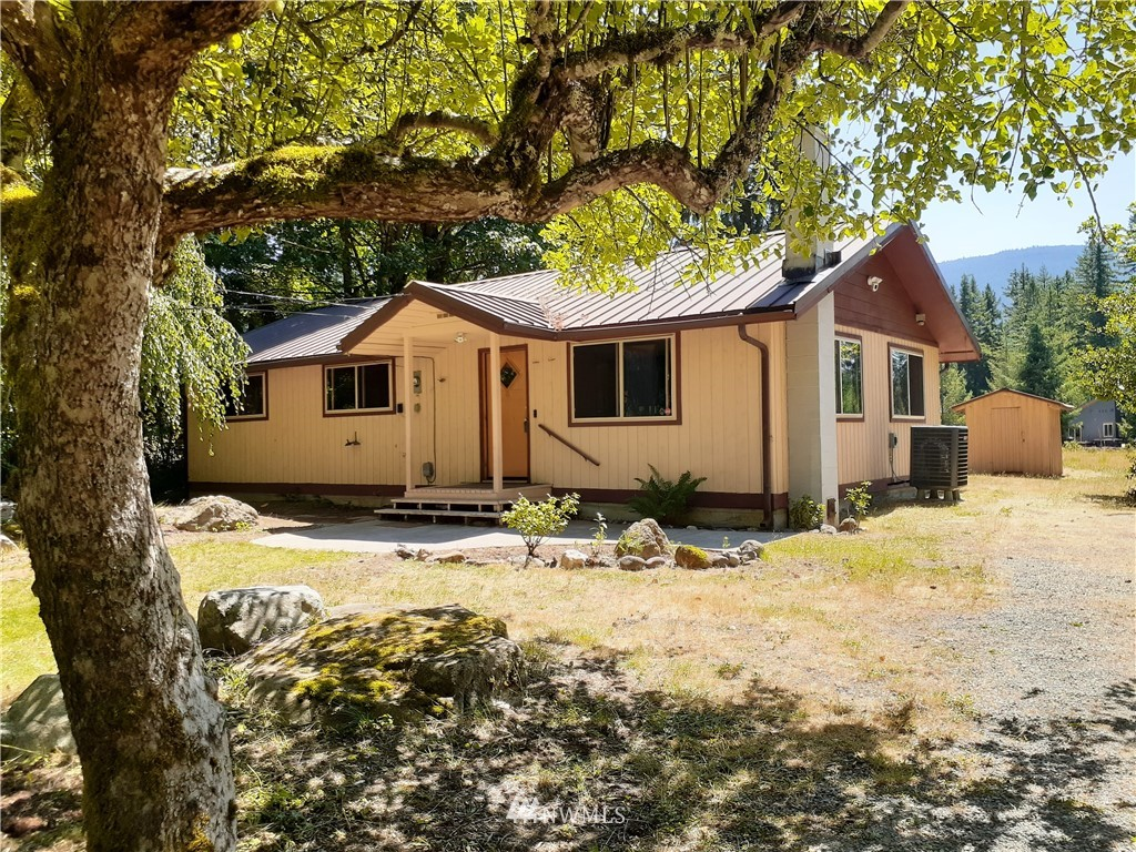 WOW the possibilities are endless with this 1-story cabin on a .34 acre High Valley #8 lot! A little updating and this would be so perfect! 2 bedrooms, bath, laundry, and outbuildings. Enjoy morning coffee watching the elk while relishing the wonderful territorial views with a peekaboo view of Butter Peak. Close to National Forest. Short distance into Packwood and access to Hwy 12 for skiing, hiking, biking, rafting, and many more outdoor activities! HOA dues include community outdoor swimming pools; community water; 9-hole golf course and community river access. This definitely won't last long!