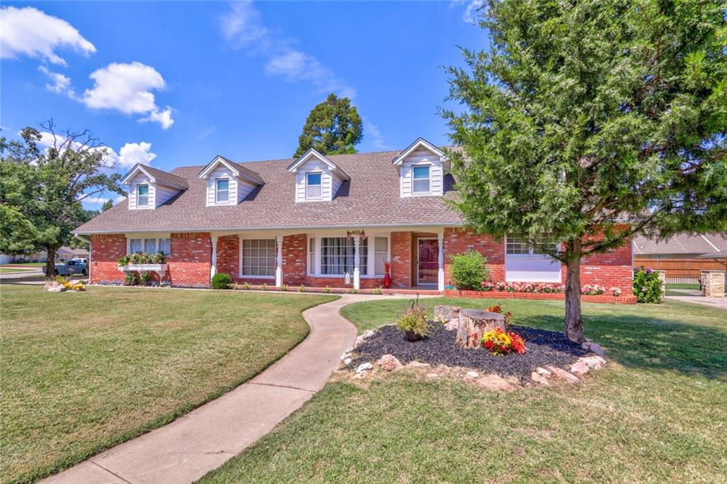 Be sure to watch the 3D VIRTUAL TOUR! You don't want to miss this home in Meridian Manor in the Putnam City School District!  Perfect for entertaining friends & family.  This home features 6 beds, 4 baths & all bedrooms are generously sized, two bedrooms are downstairs. Large Great Room upstairs can be divided into 2 bedrooms easily. One of the bedrooms has a ton of built-ins and would make a great office. Two staircases for entry to upstairs. Lots of storage everywhere.  Butlers Pantry. Granite in Kitchen. Upstairs utility room. Designated Office w/no closet. Low E vinyl double pane windows throughout and has an attic fan.  There are two living areas, one is a living/dining with a ceiling fan & fireplace & the other has a bay window.  This house features two master suites. Large back yard features covered patio, beautiful concrete swimming pool, hot tub & lots of room for lawn chairs with beautiful landscaping in front & back. Perfect for Multi-generational living.
