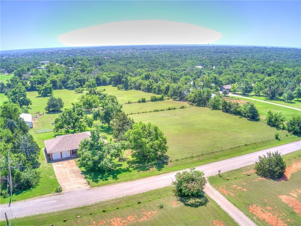 Enjoy Country Living On this 5 ACRE LOT in the Heart of Edmond!!  Take in the fresh air and enjoy the peace and quiet this acreage offers while only minutes away from Downtown Edmond with Easy Access to I-35! This 3 bedroom, 2 bath house is a Gem! Lot can be split. Schedule your showing today!! *SOLD AS IS WHERE IS WITH ALL FAULTS. Sold With All Personal Property and All Effects - Inside And Out.   Roof Replaced in 2016, Septic pumped March 2021, 2nd Well Drilled 225 FT Deep in 2012, HVAC Replaced 2018, Windows Replaced 2005, and Wood Floors under the carpet.