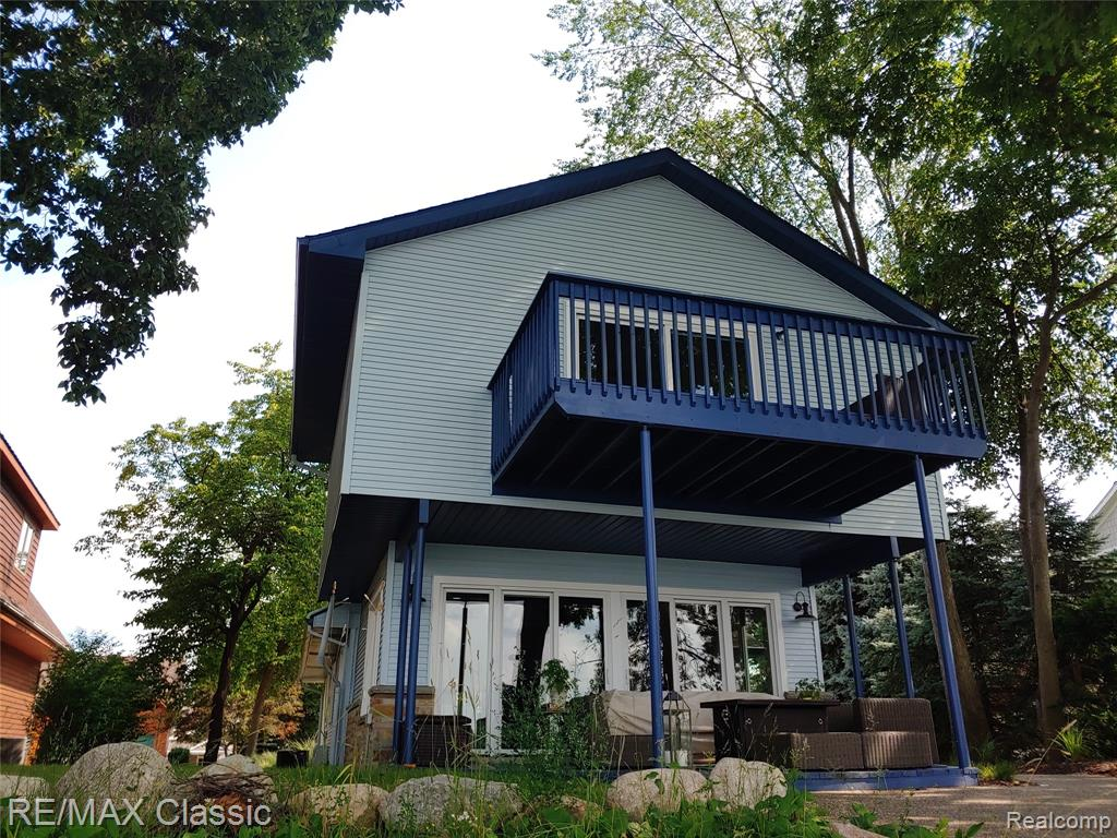 Lakefront living, one of the best views on all sports Lake Fenton! A 2,200 sq ft luxury home meets industrial with modern amenities north facing on beautiful Lake Fenton, 40 feet of sandy beach frontage, 3 bedrooms and 3 full bathrooms. Master-suite with plenty of his and her closet space provides lake views with a private balcony. Completely updated kitchen with stainless steal appliances and white cabinets. Main floor laundry. The great room offers lake views from all sides, gas fireplace, and cozy outdoor living space for entertaining. Plenty of parking and storage for all your water toys (a single and a double-car garage). Beach fire pit, boat dock and sunsets included.