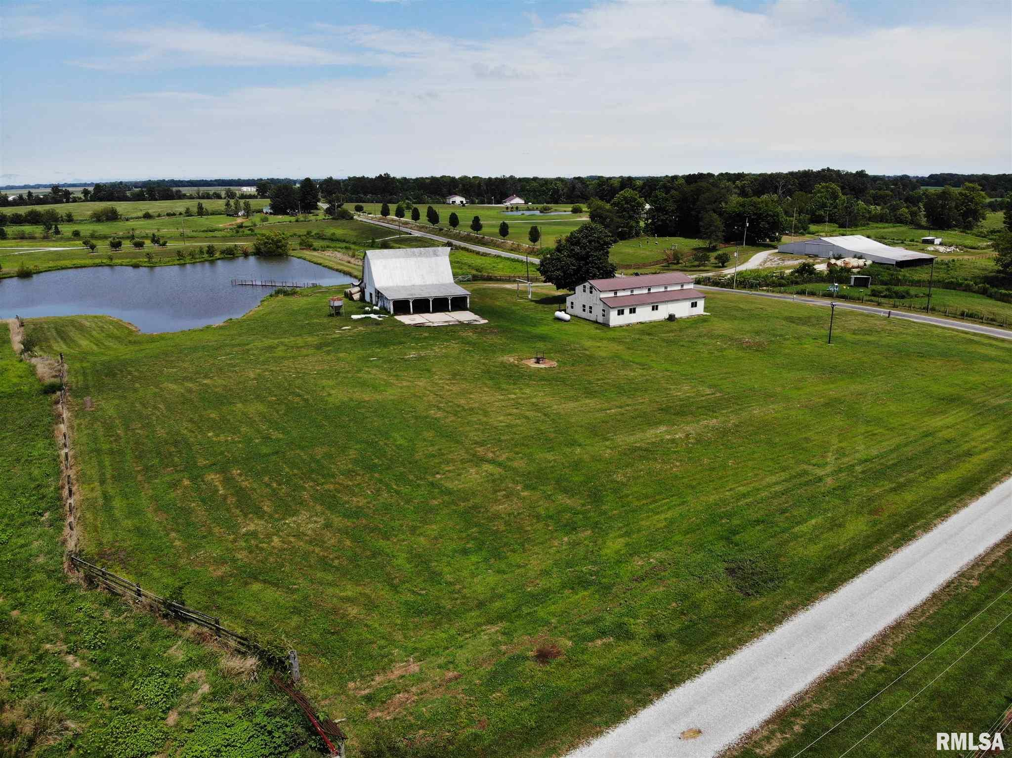 Looking for a few acres in the country, already set up for horses, goats, or any other farm animals?  This is it!  15 acres, a story & 1/2 pole building with 3600 floor area, 1680 upstairs area, (2 bedroom up, 1 bedroom down).  Pole barn has a new high efficiency furnace, new central air conditioning, new wiring and you can set it up any way you would lite it.  There is city water and propane gas.  The large wooden barn is unique too!  It is a 36X24, has many wooden stalls, a large covered lean too, large hay storage area, has lighting, new electric to it too.  To top this off, there is a large deep pond.  Property is fenced in the back.  There is also a portion completely fenced on the north side and it also has a lean to.  No close neighbors.  This property sets just outside the city limits, so it is country living, but close to town.  A must see!