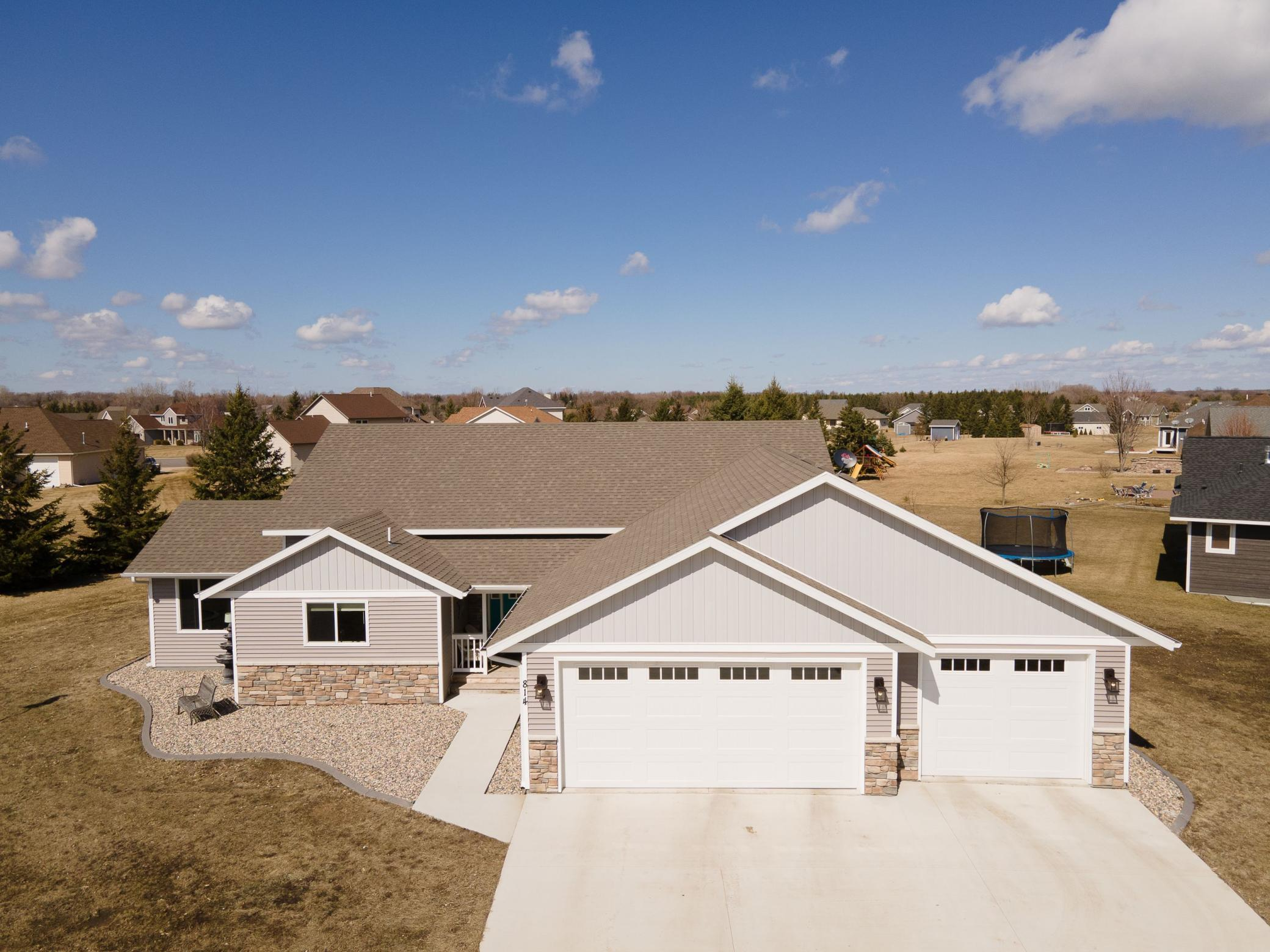 Impressive modern and classic 2017 construction with 4 bedrooms and 4 bathrooms. As you enter the home you will be impressed with the open floor plan. The kitchen features a center island with seating, a walk in pantry and white cabinetry. Relax in the sun room that has a beautiful gas fireplace, and connects to the outdoor patio area through sliding doors. Step up to the living room, master bedroom with private master bath, 2nd bedroom and full bathroom. The lower level welcomes your family for gatherings with a large family room. In the lower level you will also find 2 more spacious bedrooms, full bathroom, laundry, and storage galore. There is also a 3 stall garage with access to the main and lower level of the home. There is a neighborhood park that is right out your back yard to expand your green space. It is also close to downtown and the Central Lakes Trail! Come and look today!