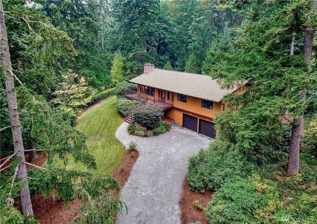 Pride of ownership shows thru-out this immaculate, custom built home on a shy acre lot surrounded by gorgeous forest views. Circular floor plan on the main level includes the kitchen w/eating space & newer apps, dining & living room w/fireplace. Owner's suite with ¾ bath + 2 additional large bedrooms. Down is a huge family room w/a fireplace, laundry and half bath. Wrap-around Trex deck (2015). Energy efficient Heat Pump/AC. Large garage w/shop area & new doors. Lake WA schools. Mint Condition!