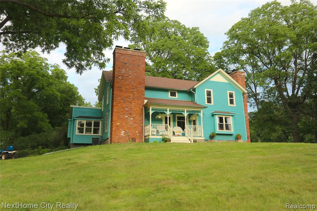 Own a little piece of history!  Nestled in the country on 15+ acres is this Charming Old Farmhouse, updated in all the right places.  Beautiful original woodwork, Hickory and Pine hardwood floors, stone and brick fireplaces and floors.  Kitchen boasts craftsman style cabinets, farmhouse sink, stainless steel appliances, double oven and stunning granite countertops.  Cozy window seating in kitchen eating area has amazing views of the barns.  Two completely updated black and white bathrooms. Four original wood burning fireplaces.  Three spacious bedrooms all with views of the countryside.  Don't miss the beautiful 100+ year old barns that are not just nice to look at but are still in working order!  15 sprawling acres with pastures and woodlands.  Stunning rock patio and staircase out back.  Located just minutes from Downtown Metamora with it's shops and restaurants. BATVAI