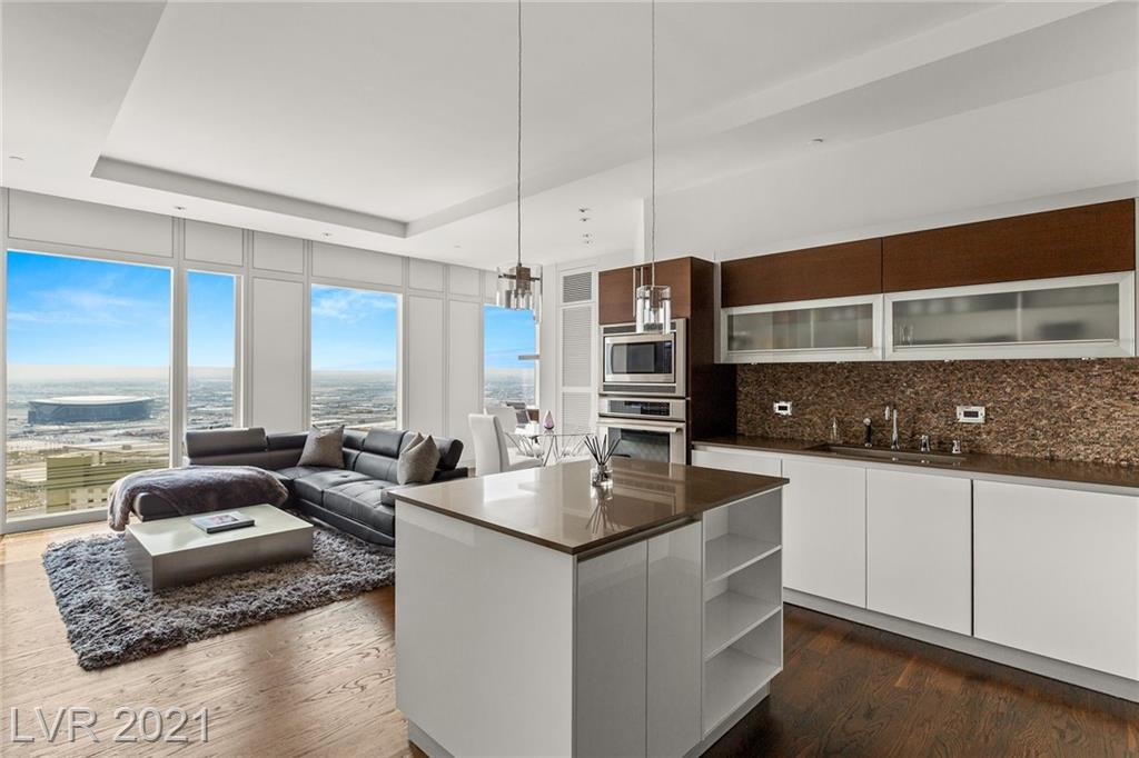 Perched high on the 38th floor, this stunning turnkey residence provides panoramic views of the city, mountains, airport and the new Raider stadium. This sought after floor-plan offers generous open living space with family room, office area and nook open to a large kitchen complete with stainless steel appliances, built-in refrigerator, center island, wine refrigeration and breakfast bar. The primary bedroom is accompanied by a spa like bathroom featuring dual vanities, stand alone soaking tub, walk-in shower, built-in closet and custom chandelier. This unit is set apart with unique features such as dark wood floors throughout, custom lighting, built-ins, modern furnishings, Sony televisions, Sonos sound and superior views that you won't find on lower floors. You'll notice the difference the moment you enter. Nothing compares! Accompanied by world class amenities at the Waldorf Astoria, this the ultimate in luxury high rise living on the Las Vegas Strip. Owner will provide financing.