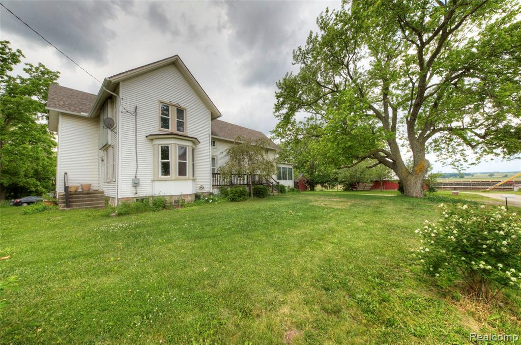 Welcome home to this charming 2-story farmhouse in Saline Twp.! This home offers several updated items over the last 10 years including plumbing and electrical, tankless water heater, furnace, 2 A/C units, septic tanks (2018), appliances (2020), roof, water softener (2019) and reverse osmosis purification system (2019)!  First floor master suite includes spacious master bath with laundry area. Large living room includes sunny bay window. Two staircases lead to the upper level with 3 large bedrooms and spacious landing perfect for play area or additional living space. There is a bonus attic area which can be finished as well.  Outside there are many fruit trees including apple, peach and pear with mulberry and blackberry bushes nestled among the beautiful acreage, a roomy shed/barn, and large garage/pole barn. Glass/screen enclosed sun room is a welcome addition for enjoying the changing seasons. Many tools in the shed/barn are negotiable!  Schedule a showing today!