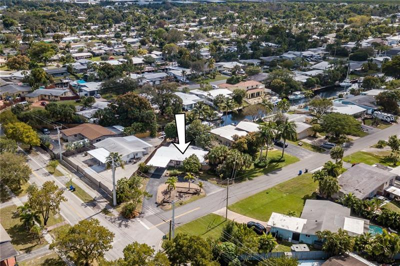 Pie Lot in Lauderdale Isles w 20 ft of water.  Huge front yard and driveway with plenty of room to park a boat or two.  3 Streets from Lauderdale Isles Quiet Boat Ramp.  House is very clean and nicely appointed with tile in the common areas, wood in the bedrooms and remodeled baths.  Impact windows and doors throughout with huge slidlers along the whole back of the house.  Two bedrooms having access to a 420 sf screened in porch great for entertaining and keeping doors open bug free.  Roof just completely sealed with Gaco primer and sealant including transferrable 7 year warranty.  Landscaping ready for your personal touches.  AC in 2013, Electrical upgrade in 2011, Roof Sealed 2021, Windows 2014, porch 2018.  See pic of permit history. Solid House ready for a new family!