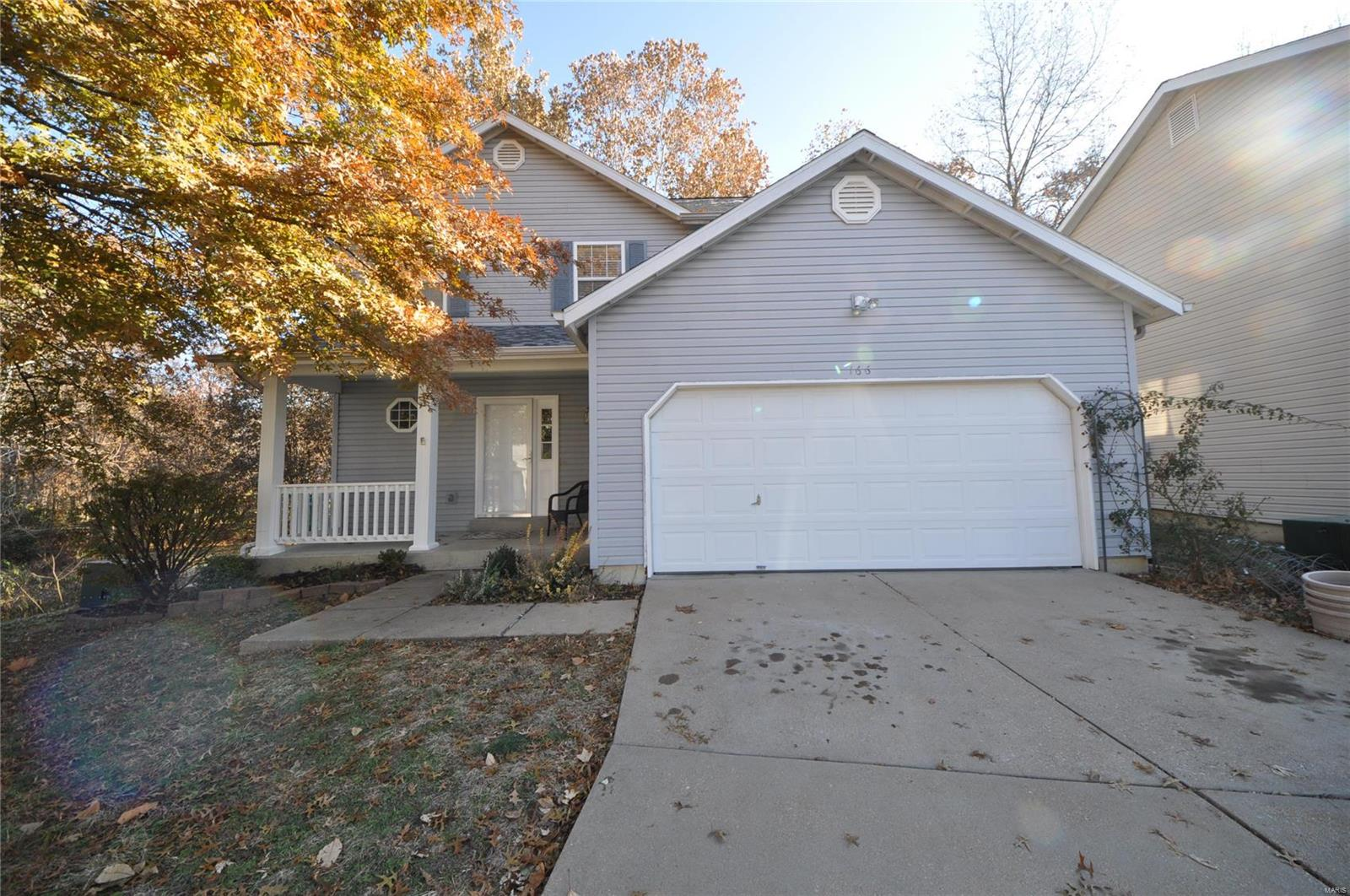"""Beautifully updated 3 BDRM, 2.5 BTH 2 STY home in Parks at Woodlake sub on perfect lot backing to common ground & trees/woods less than 2 miles from HWYs! Exterior includes new roof (2016), freshly painted soffit/fascia (2019), 2 car garage, covered porch & over-sized deck overlooking lot w/HUGE lot of common ground to side & open/wooded ground to back. Updated interior includes open floor plan concept starting with spacious entry foyer. Great rm w/wall to wall bay window & marble WB FP w. Newly renovated eat in kitchen w/center island w/BB, granite counter tops, SS appliances, 42"""" cabinets & bay sliders out to deck. 1/2 bth on main. New laminate flooring throughout main level (Nov 2019). Upper level feat master bdrm suite w/walk in closet & full bth. 2 add'l spacious bdrms & full bath upstairs. Unfinished LL waiting on your finishing touches! More updates include freshly painted interior (2019) & new ceiling fans (2019). Includes ALL Lake Saint Louis lake amenities! MUST SEE!"""