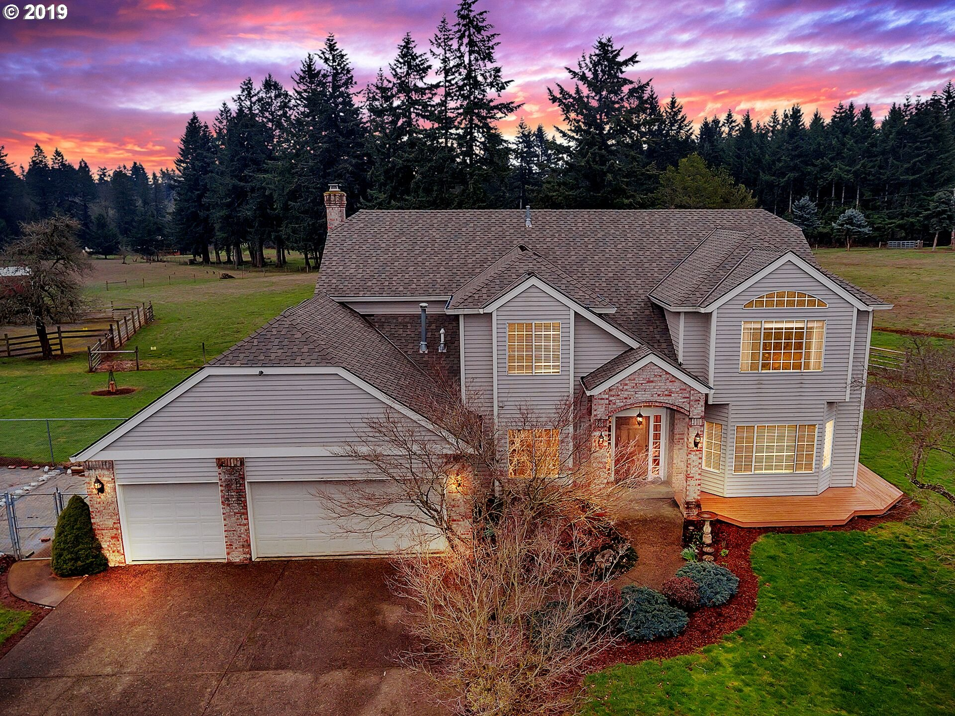 Fantastic Equestrian estate! Spacious custom built home on nearly 10 level pasture acres! Quiet private road leads to your country oasis, lovingly cared for home is awaiting your family! Enjoy beautiful sunset views & cozy fire pit/entertainment area,barns/shops include 36X36 (concrete floor),36X18/12X24loaf shed- all fenced & cross fenced pastures.  Electrical/&pad for Hotwalker--Upgrades include craftsman woodworking,tile, oak marble