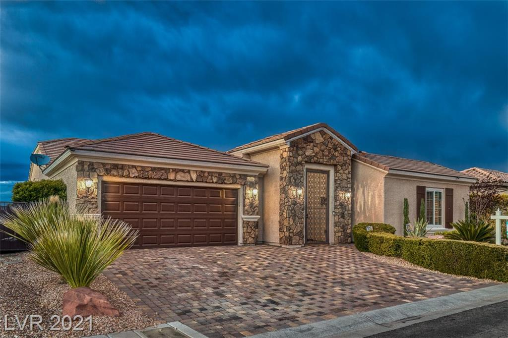"""3320 SQUARE FEET UNDER ONE ROOF-SPECTACULAR CUSTOM HOME-PLENTY OF SPACE FOR HOME OFFICE AND THEATER ROOM-GOLF COURSE AND FULL STRIP VIEWS-OVERHEAD STORAGE IN GARAGE AND NEWLY PAINTED GARAGE FLOOR-HUGE CUSTON CLOSET-5 BEDROOMS 3 1/2 UPGRADED BATHROOMS-LAMINATE, ONYX AND TILE FLOORING THROUGHOUT-CROWN MOLDING AND 5"""" BASEBOARD-BUILT-IN WALL UNIT AND BAR AREA-BOSCH STAINLESS STEEL APPLIANCES-DOUBLE OVEN-NEWLY EXTENDED GRANITE KITCHEN COUNTER TOP-SUB ZERO REFRIGERATOR AND FREEZER-CENTRAL VACUUM AND HARDWIRED SECURITY SYSTEM WITH 8 CAMERAS-RING DOORBELL AND BLUETOOTH THERMOSTAT-SURROUND SOUND AND EQUIPMENT-SHUTTERS-CUSTOM CLOSETS-ATTACHED SAFE IN CLOSET-HEATED POOL AND SPA-FULLY FENCED LOW MAINTENANCE BACKYARD-MONSTER SECURITY TINTING ON WINDOWS-GREAT ENTERTAINMENT HOME"""