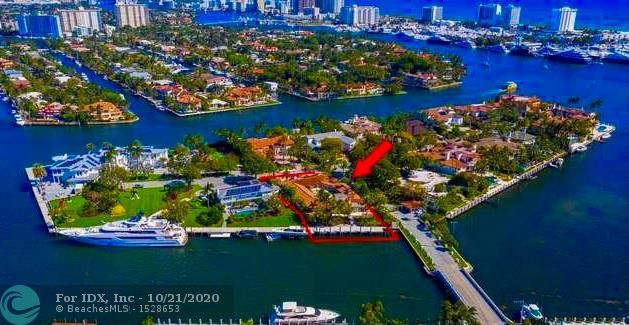 HARBORAGE ISLAND! The address says it all ... 1 Harborage Isle. The most exclusive address in South Florida. One of the last opportunities on exclusive HARBORAGE ISLAND to build the home of you dreams or remodel the current structure. 24 hour armed guard at the gate, with only 16 homes on this Prestigious address.  Dock your 100feet yacht behind your house on the newly built dock, with quick ocean access.