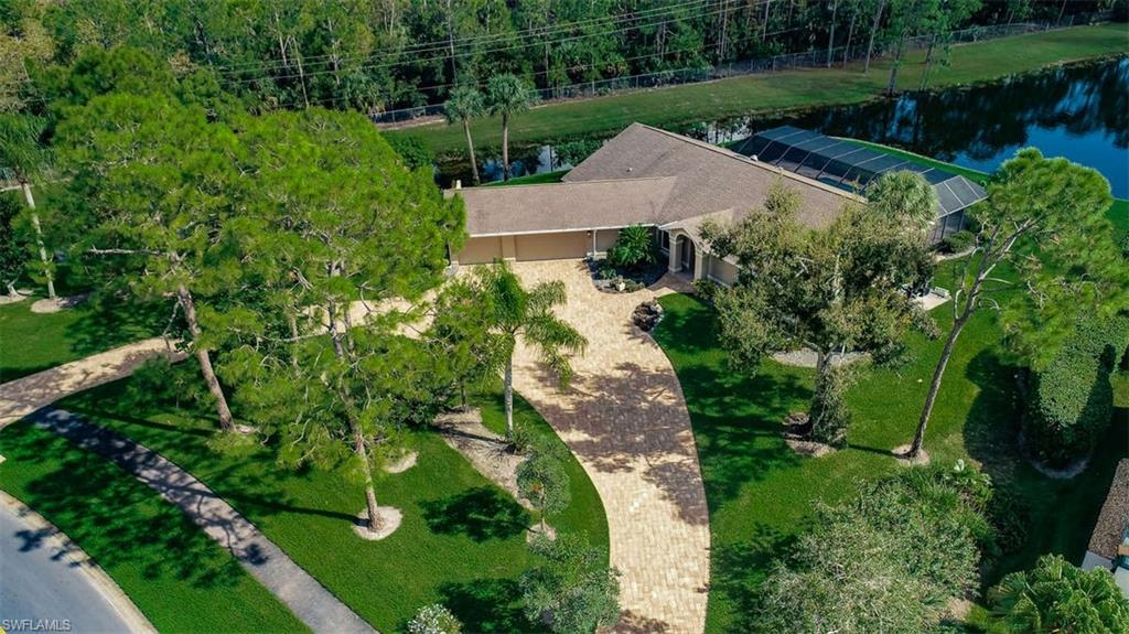 Immaculate single family pool home with 3 car garage and stunning Southern lake views is move in ready and located in one of North Naples most desirable communities. Featuring upgraded gourmet kitchen, split floor plan, volume ceilings, plantation shutters and newer paver circular driveway all situated on a lushly landscaped peaceful and private oversized lot and a half. This beautifully maintained home comes with hurricane impact resistant windows, Astroguard storm protection,  a generator transfer switch, newer salt water pool system with new pool pump and much more. Imperial Golf Club offers a variety of optional memberships available to the buyer but are NOT mandatory. Located  just minutes to award winning beaches and fabulous dining and shopping, Imperial Golf Estates is guard gated, pet friendly and a wonderful place to call home! Don't miss this opportunity to own paradise today!