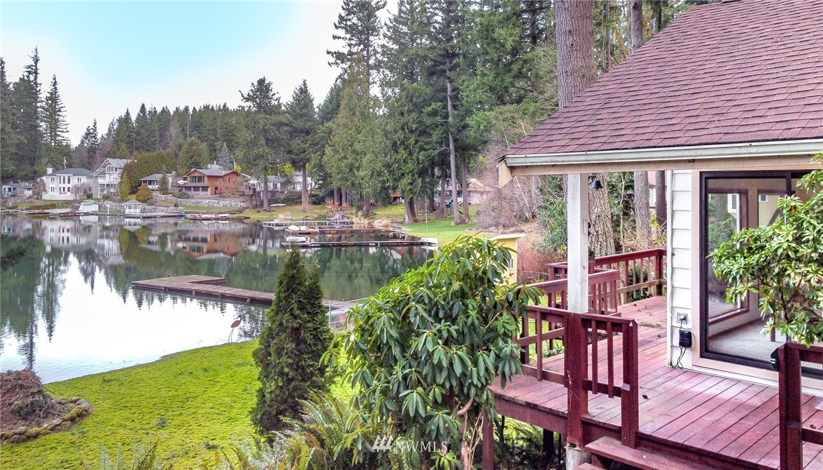 Charming home with 50' feet of lake front on highly sought after- Lake Retreat! Just mins to Maple Valley's shopping & restaurants & Tahoma school district lies this private & picturesque 50 acre lake. Well maintained & loved cabin features 1/3 acre lot, detached garage & one-story home w/fully finished basement. Main floor has vaulted family room w/walls of windows taking in the gorgeous views, fireplace & opens to kitchen & dining space. Master bedroom on main floor has closet & bath across hall. Basement has multi-use space/office & bed w/closet. Nice level back yard & dock out to the lake. This lake is great for swimming, boating, fishing- quiet & peaceful retreat. Enjoy the vacation feel while in the comfort of your own home.
