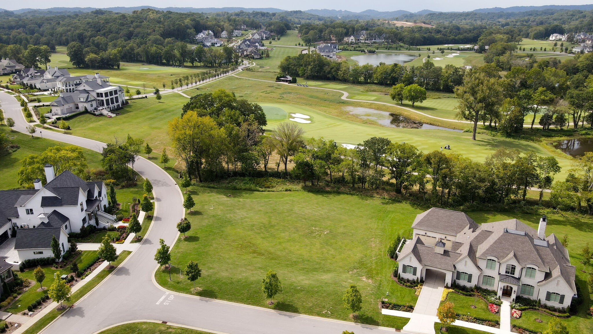 A one-of-a-kind golf course homesite overlooking a creek, the 10th fairway and green along with the 13th green of our Greg Norman Signature golf course! This homesite is .66 acre and is perfect for a lower level walk out basement home and is tucked into one of our few fully-developed neighborhoods, so there will be minimal construction around this home in the future.  If you are a golfer, there are few better homesites than this one at The Grove!