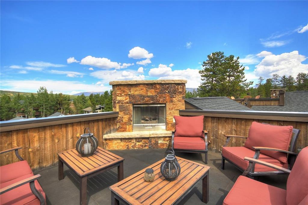 Panoramic views from the rooftop deck of this lovely residence in Frisco. Town dining, shopping and activities are only a quick walk away. Two bedrooms plus sleeping loft and multi-use lower level provide plenty of room for family and friends.Proven rental history. Architecturally designed with creative angles and natural materials. Loads of storage, one car attached garage makes this a true gem. Hiking trails and bike paths right out your door! Perfect location, perfect place to call home.