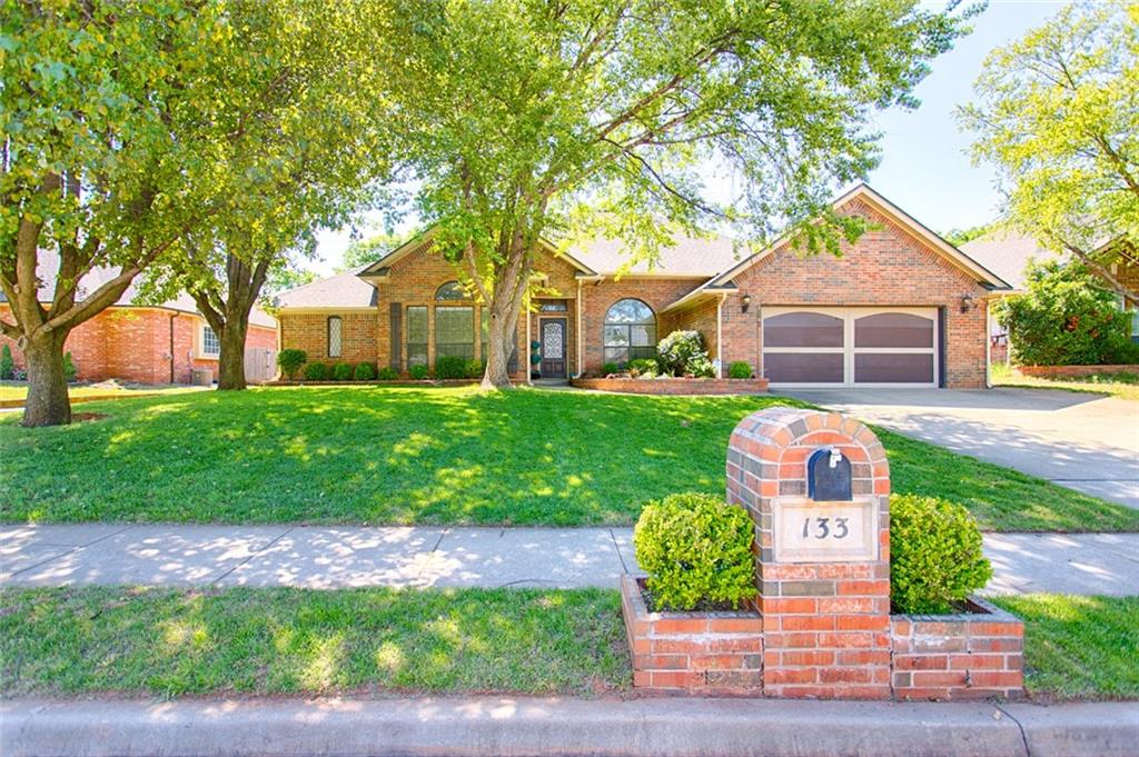 Welcome to this beautiful, traditional style home in the Winding Creek addition. You'll love the amazing burb appeal and functional floor plan of this home that features hard wood floors throughout.  Four bedrooms, 2.5 baths with 2 living areas (2nd living area can be used as an office) and separate master suite on opposite side of the home. Huge master closet with built-in dresser. Oversized gourmet kitchen, features granite countertops, tumbled marble backsplash, large center island, pantry and glass kitchen cabinets with a ton of storage space. Large breakfast area with a ton of natural sunlight and built in wine rack and storage. Main living room boasts a floor-to-ceiling fireplace with wooden beam and built-in bookcase.  Large, landscaped back yard with mature trees and covered patio. New roof and new carpet. Storm shelter in garage.