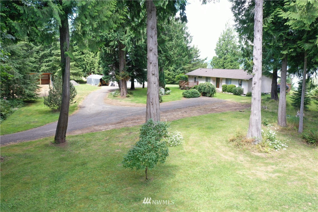 Rare RIFFE LAKE view! Enjoy the seasons on this 1000 sq ft deck. Over 5 acres with a horse paddock, large shop and outbuildings, this place is a gem! 2-3 bedroom, whichever you prefer. PRIVATE, dead end road. This one will go fast! BUYER GOT COLD FEET!