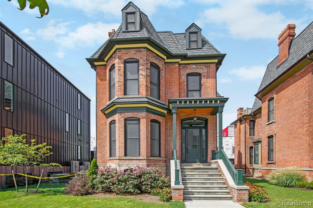 After a full historic preservation, true character remains while elevating this space with today's modern elements! This condo encompasses the entire original home and has the low-maintenance benefits of condo living! Private entry from the covered front & back porch! Featuring 3-stories, 4 bedrooms, 3 full and 1 half bathroom w/ large bonus room on the 3rd floor! Soaring ceilings, dark hardwood floors, exposed brick & moldings are throughout. The main floor includes multiple rooms for living, open kitchen with grand island & stainless appliances. Upgrade credit for Appliances! Located in Detroit's Brush Park, this home sits among few other historic gems & multiple phases of new construction townhomes & apartments. Every direction, you're steps from all major sports teams, the best restaurants, bars, museums, & cultural institutions! Walk 1 block to the QLINE or walk, scoot, bike ride anywhere in the city! NEZ tax abatement & garage parking right out your back door!