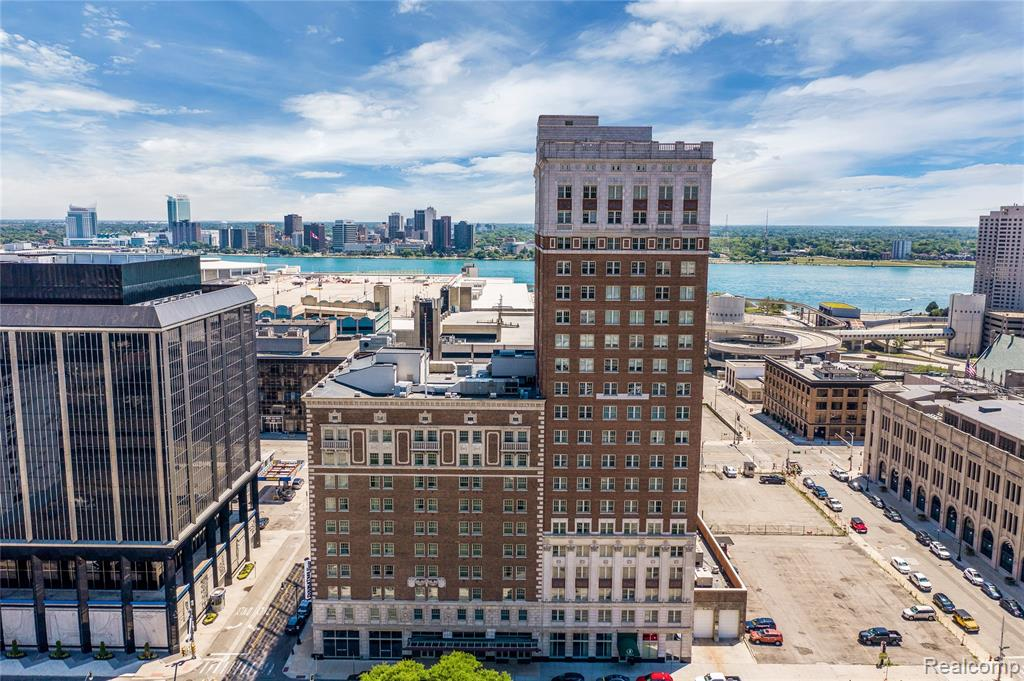 Immerse yourself in the views of the Detroit River from high above the City! The Fort Shelby Residences offer a unique lifestyle with extreme walkability (Walk Score of 90). Step next door to the Press Room for a coffee or a fresh baked pizza, stop by a concert at Campus Martius or stroll to the Riverfront walk. As you return to the lobby, enjoy hotel-like amenities with a residential concierge, residential lobby, electronic package lockers, fitness center, coffee shop and restaurant. Your dedicated secured parking space is accessible through a private side door keyfob-controlled. Take the elevator to the 19th floor and discover this rare corner unit floorplan with 9 windows on 3 sides and its incredible river views. Premium finishes are carefully curated throughout with engineered wood floors, stone-tiled bathrooms, premium carpet in the bedrooms, marble-effect quartz counters and stainless steel appliances. This unit benefits from the NEZ property tax abatement until end of 2033.