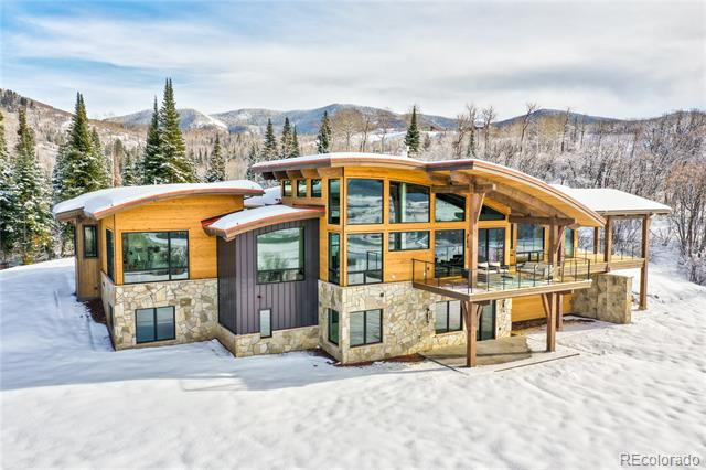 Sunset Retreat is a stunning mountain transitional home nestled within Alpine Mountain Ranch & Club, Steamboat's 1,216-acre land preservation community located only 7 minutes from both downtown and the ski mountain. A secluded arrival through towering pines reveals the welcoming courtyard entry anchored by stone and timber and capped by an artful combination of barrel and gable roof forms paying homage to the surrounding peaks of the Yampa Valley. Once inside, dramatic views wrapping the spacious great room invite you to experience the magical sunsets from the covered deck off the chef's kitchen. An elegant master suite, study and a private guest suite complete the main level with 3 additional en-suite bedrooms, family room and patio on the lower walk-out level. The Owner's Lodge is your base camp for exploring AMRC's 900-acre open space preserve, private fly fishing on the Yampa River and exclusive access to the Alpine Mountain Summit Club at the base area. Welcome to Sunset Retreat!