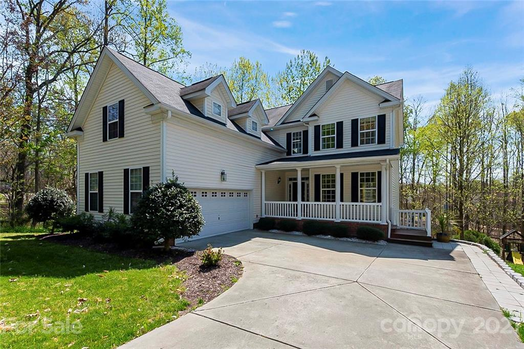 This Charlotte two-story home offers a two-car garage.