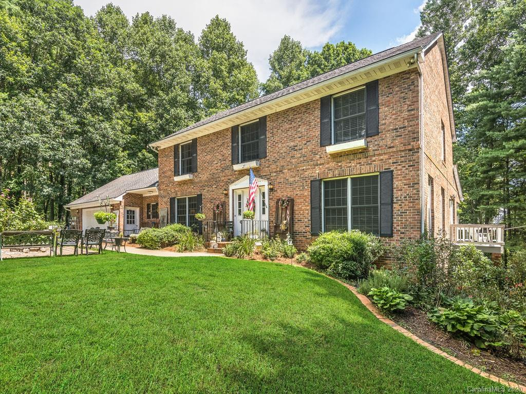 Seller is motivated! Beautiful brick home located in desirable Flat Rock, N.C. Perfectly suited for today's living requirements, this large home offers tons of space for comfortable at home living. Spacious rooms include formal living and dining rooms, two family rooms, one on the main level and the other in the basement, a large eat-in kitchen, 16'x25' bonus room above the garage (not included in heated square footage due to sloped ceiling heights), many bedrooms, office spaces, walk-in closets, a 2 car garage on the main level with workshop area, 1 car garage on the lower level, 2nd living quarters with kitchen on the lower level has painted concrete floors. New HVAC system. Beautiful level front yard and private wooded backyard. Conveniently located just 5 miles to downtown Hendersonville. Sellers will give Buyer a $10,000 credit/allowance for updates at closing with an acceptable offer!