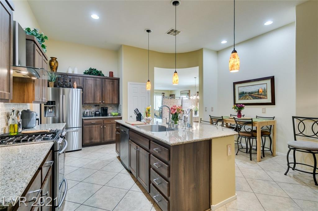 AMAZING SINGLE STORY IN WATERFALL GATED COMMUNITY! ONLY FEW STEPS AWAY AND ON SAME CULDESAC AS PRIVATE PARK W/ GORGEOUS MOUNTAIN VIEWS, WALKING PATH, PICNIC TABLES & SPLASH PAD! HOME FEATURES OVER 2100SqFt W/ 3 LARGE BEDROOMS/2BATHS/2CAR AND HIGHLY DESIRED OPEN FLOOR-PLAN. GOURMET CHEF'S KITCHEN BOASTS 12FT VAULTED CEILINGS, LARGE GRANITE ISLAND, PANTRY, BREAKFAST BAR, PENDANT LIGHTING & STAINLESS STEEL APPLIANCES. GREAT FOR ENTERTAINING W/ SPACIOUS LIVING, DINING & FAMILY ROOMS.....NEWLY PAINTED & MOVE IN READY! ENJOY FRESH AIR AND VIEWS FROM YOUR FRONT PORCH TERRACE AND PRIVATE BACKYARD. FIVE MINUTES FROM ALIANTE RESORT, RESTAURANTS AND SHOPPING! COMMUNITY AMENITIES ALSO INCLUDE WELL MAINTAINED CLUBHOUSE, FITNESS CENTER, POOL/SPA, BBQ'S, INDOOR AND OUTDOOR FIREPLACES! SOLAR ALREADY INSTALLED..ARE YOU READY TO MAKE THIS YOUR HOME TODAY.....Owners are in the process of pulling carpet from guest rooms and adding laminate flooring.