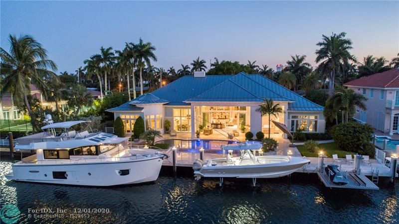 The Hampton's meets Harbor Beach. Chic, Coastal-inspired Deepwater Estate. This single-story custom estate is sited on 120'+/- of waterfrontage in Fort Lauderdale's most desirable waterfront setting. Soaring, high-volume ceilings give way to the open and light-filled interiors with window walls of glass. A custom designer kitchen features stainless steel appliances, gas range, custom cabinets and adjacent breakfast table with floor to ceiling windows. Grand master suite features intricate ceiling and wall details along with separate sitting area. Private guest wing with three bedrooms and a garden front office. Outdoor resort entertainment at the expansive pool w/sun shelf and a 12-person spill-over spa. 120'+/- concrete yacht dock capable of hosting up to 100'+/- vessel