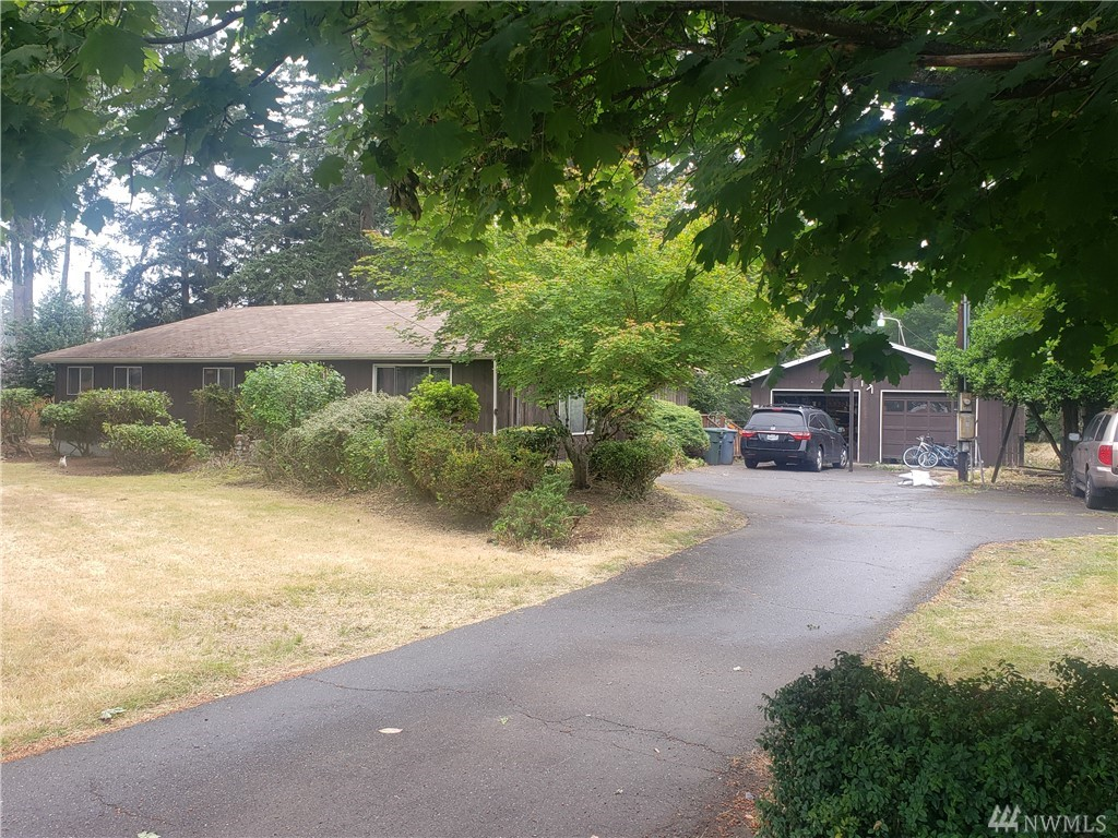 Rambler on 2.42 acres +/- with detached 2 car garage. Currently used as a rental. Owner has preliminary Short Plat with Pierce County for 6 additional lots. Purchase and finish the project. Use the current home as a rental with future development potential.