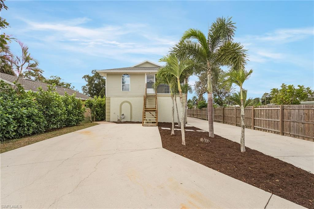 Multiple offer situation, highest and best due by 11/24 4pm est. The most desirable property minutes from downtown Bonita Springs, Barefoot Beach, and Coconut Point is now available. You can enjoy the western exposure with beautiful sunsets every evening from your second-floor deck or while you're eating your dinner in the screened in lanai. Located within 1/2 mile of Riverside Park, this property has been completely remodeled, with stainless steel appliances, calacatta marble island, and an addition of an entirely separate guest house on the first floor (2/1), making it one of the most unique properties available complete with 1969 sq ft, 4 bedrooms, den, and 3 total baths. Enjoy the privacy offered by the 10-foot hedges, fencing, and a gated driveway. Outdoor living area with brick pavered patio, pergola with string lights, and synthetic turf dog run. And with over 3500 sq ft of driveway, and an oversized single car garage,  there is plenty of room for all of your vehicles and toys. Roof was replaced in 2018, and both AC units are new. Property is located in Flood Zone X meaning Flood Insurance is not required. The guest house is under lease until 2/28/21 at $1350/month.