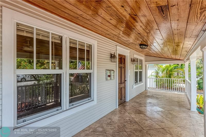 OLD FLORIDA CHARM! Fantastic 2 bed/2.5 bath home with a 1 bed/1 bath guest suite above the 2 car garage. The main house is full of charm with mature trees, large front patio, decorative woodwork & real fireplace. Hurricane Impact windows & doors, wood floors, 2015 a/c, large private yard. Updated kitchen with breakfast bar. The fully fenced yard is currently separated to provide privacy between the units. Remove the fence & add a pool! Main yard has a firepit, BBQ, gazebo & is a great space to entertain. Long side driveway leads to the 2 car garage.Great for an RV, boat, or to park cars.Guest suite has a full kitchen, separate laundry & storage room, & can be rented for income or be the perfect home office! Enjoy the tree lined streets of Victoria Park & easy access to Las Olas & the beach