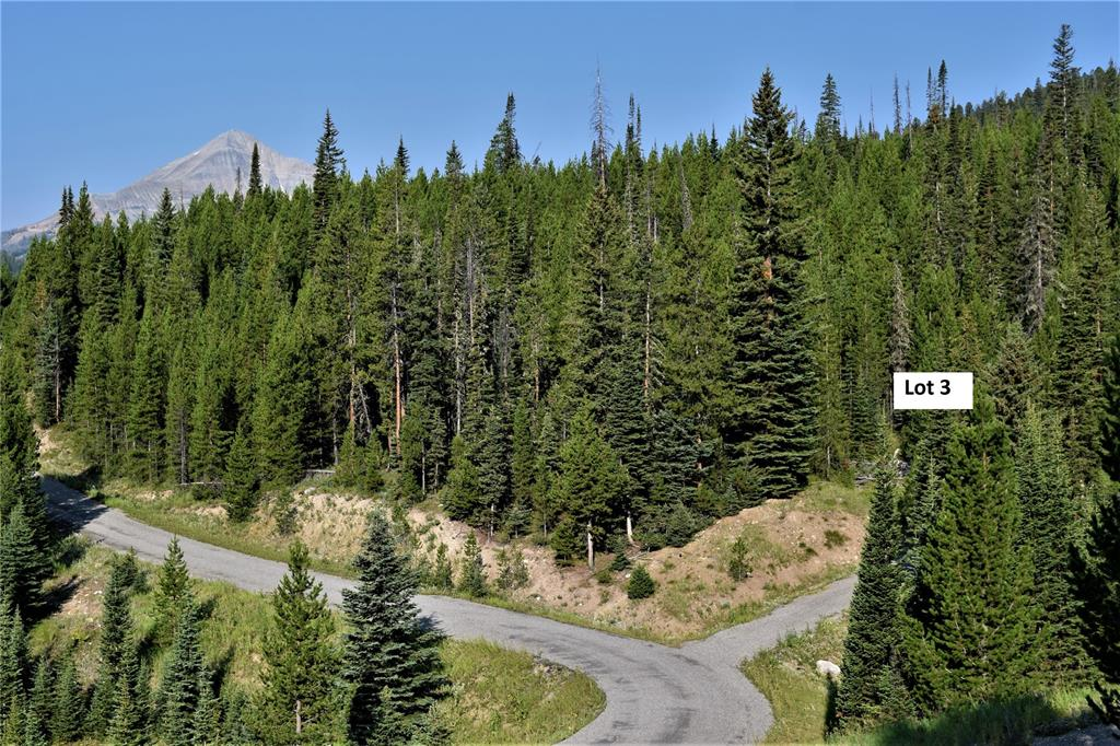 This beautiful 6.31 acre home site provides seclusion in a tranquil setting in a 5-lot development part way up the mountain, but it is just minutes from both the Mountain and Meadow Villages of Big Sky.  Heavily treed with rolling terrain, the driveway is in and electric is to the lot.  There is a charming surface water creek, so wildlife is plentiful.  Build your Big Sky home here and enjoy peace and solitude with all of the area amenities of Big Sky nearby.