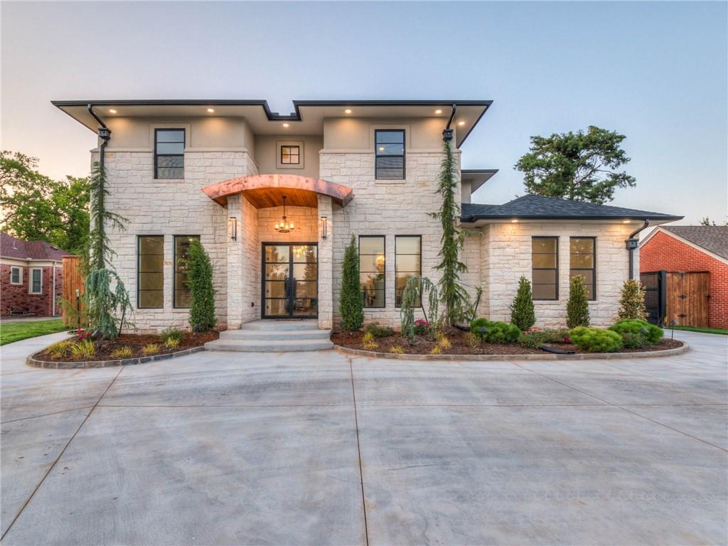 Modern LUXURY lives here! Forward Thinking Stack Stone Design nestled in the HEART of Nichols Hills. This Home of Distinction is reminiscent of a high style residence in Austin. Exceptionally crafted (5 bed, 4 full & 3 half bath, Study, & Bonus) floor plan that facilitates the everyday flow of life. EXPANSIVE Chef's Kitchen features soaring ceilings, large walk-in pantry & serving bar, top of the line stainless appliances w/ gas range (of course), & loads of ample work space. STATEMENT Staircase and DESIGNER Marble fireplace. Natural light throughout the residence. Catering utility space & magnificent master suite. 3 bedrooms downstairs(rare). Large upstairs media room pre-wired for surround sound. The BEST in DESIGN. Smart features are endless & energy efficient. PRIVATE, electronic gate entry. Foam insulation. Pool/Spa w/LED lights, infinity edge w/waterfall, & heated. This home will TRANSFORM your LIFE! Tailored to last. Truly exceptional. See to believe! You won't want to leave!