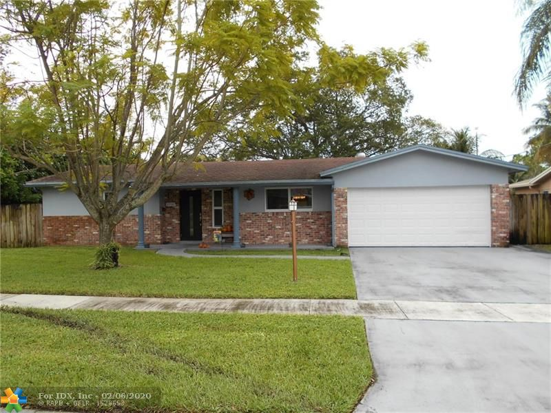 AMAZING FIND! Open and spacious 3 bedrooms, 2 full bathroom home with over-sized 2 car garage. Impact glass windows doors throughout. Newer A/C.  Light & Bright! Large tile flooring. Backyard has tranquil setting with mature trees, large re-diamond brighted pool, great for entertaining. Canal view. Walking distance to Broward Community College. Super convenient location near FL Turnpike, I-95, schools, shopping and everything South Florida has to offer.