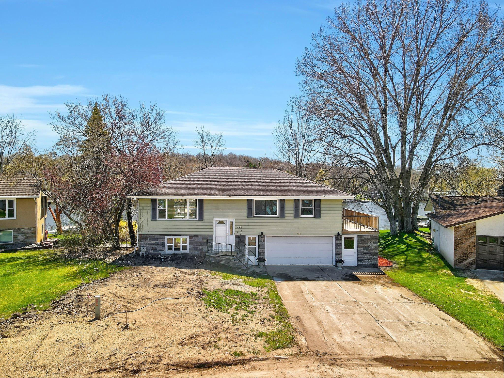 What an amazing and rare opportunity to own this fantastic home right on the Sauk River!  Roughly 104 ft of shoreline and your own dock to launch from.  Gorgeous views and river access yet just minutes from shopping and town center.  Extensive remodeling, new quartz kitchen countertops, main-level plank flooring.  Walkout basement with bar area.  Nice bright and open floorplan with almost 2,000 sq ft finished.  2011 saw a new roof and some new windows.  Most new windows in 2021 (new patio door too).  Huge back deck.  New insulated garage door to be installed soon. Sellers also replacing front door, rear door and door into home from garage. New concrete front steps to be poured when weather permits.  The home received new water main and sewer main beginning of 2021 and the front yard will be final graded and grass seeded.