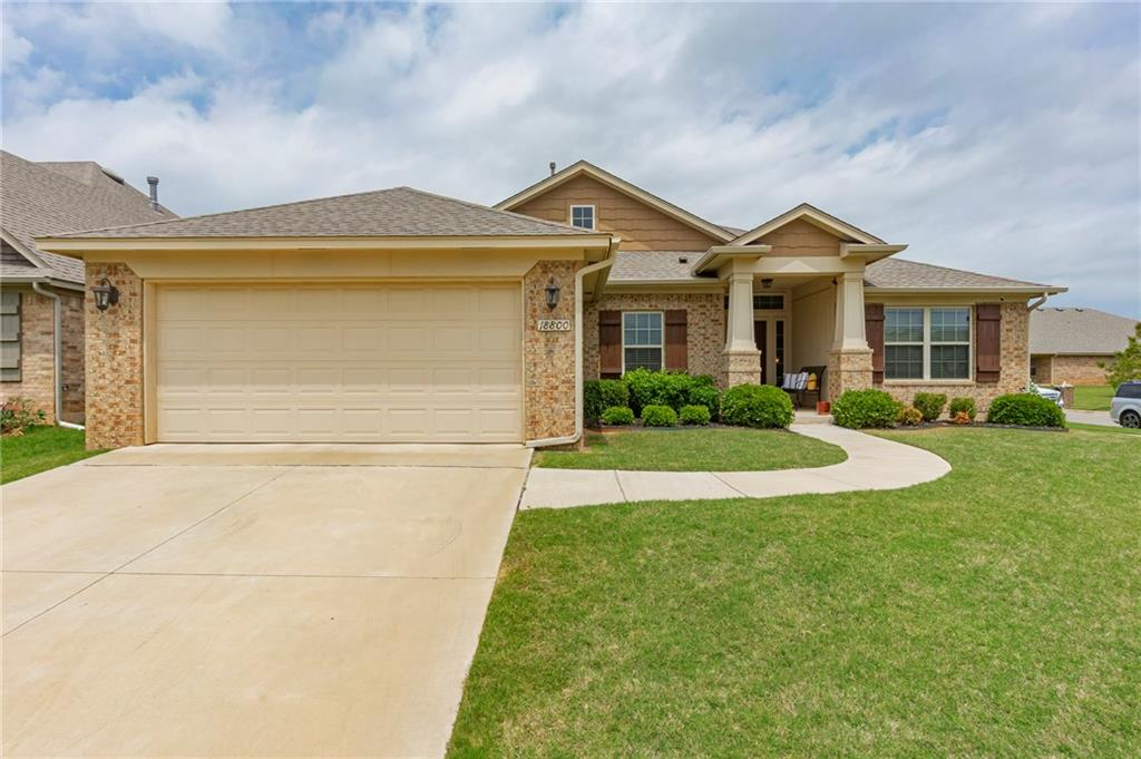 Gorgeous Valencia home in Deer Creek School District! The covered porch and landscaping welcome you into the bright foyer. The living room has a gas fireplace with stained wood mantle, ceiling fan and is open to the spacious kitchen. A breakfast bar, pantry, Quartz countertops eating space and gas stove complete the kitchen. The master is a suite with lots of natural light, walk-in closet, double sinks and a nice soaking tub. The other 2 bedrooms are nicely sized and have amazing closet space! Another great bonus of this home is the big, 8-person tornado shelter in the garage. Neighborhood amenities include multiple playgrounds, sidewalks, gazebos, community pond and splash-pads. Conveniently located to Kilpatrick Turnpike, I-44 and UCO. Schedule a showing of this beautiful home today!