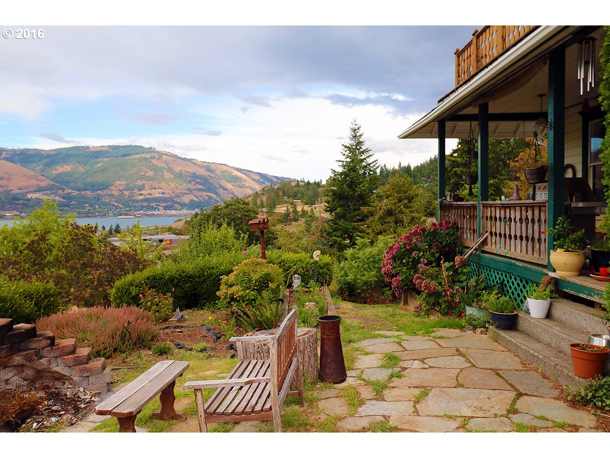 Spectacular 180 degree view of Columbia River & mountains-Watch the wind surfers-walk to downtown.1906 Craftsman home w/charm & character intact-spectacular views from main floor & master! Original wood floors main floor & up-Formal dining room-Sunroom off kitchen-3 remodeled bathrooms-Lot is over half an acre-Possible separate lots Buyer to do due diligence w/city of Hood River. Rent $2300/mnth