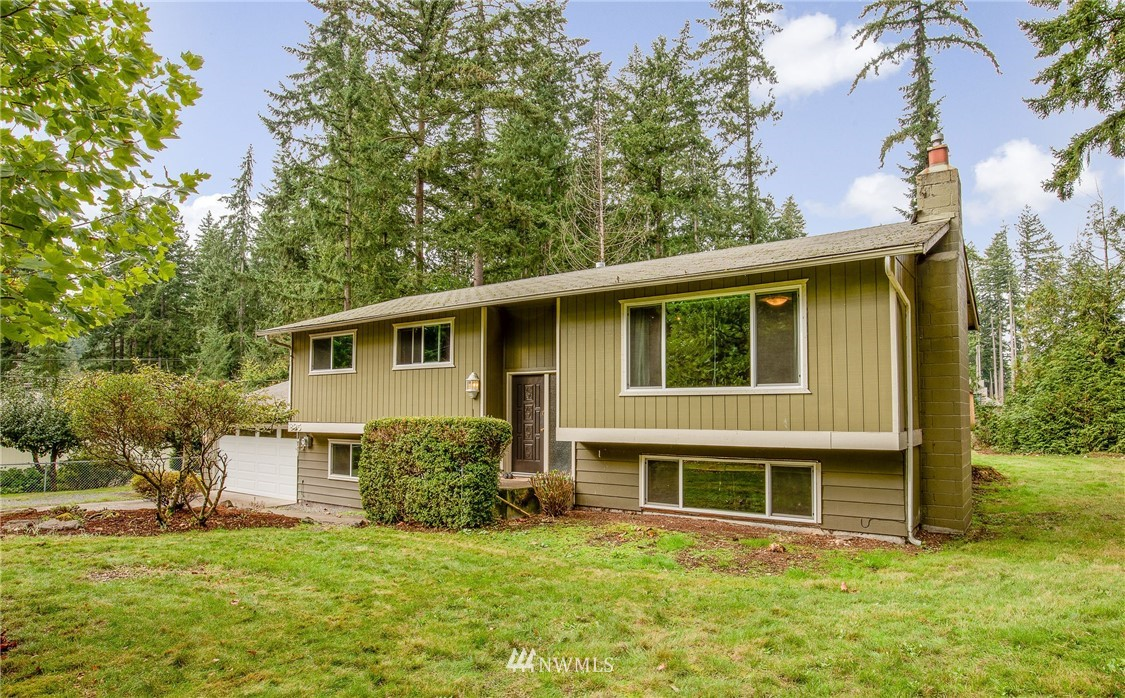 Opportunity knocks in Sammamish. Centrally located near schools, lake and shopping. Ready for your updates or fix and flip. Great bones on a large, flat, private lot at end of cul-de-sac with no HOA or CC&R's. Home has owner's bedroom with en suite and second bed up plus a 3rd room (no closet) for study, work, exercise, or zooming. Lower level has a separate entrance, kitchen, second laundry, huge great room, and 2 more bedrooms. NEW 5 bedroom septic system! Flexible living and investor options!