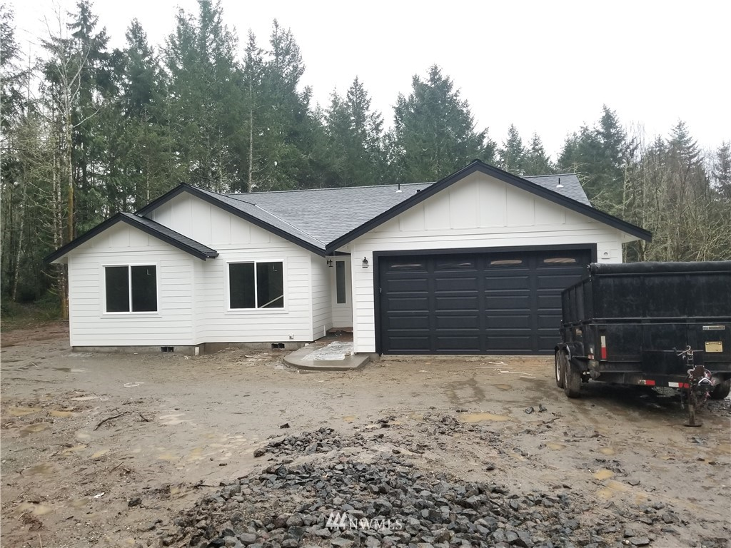 Here is the single story home you have been waiting for: Privacy abounds in this 1,500 sqft New Construction home in Lakebay on 3 acres of land. 3 bedrooms and 2 bathrooms, separate laundry room and laminate plank throughout the home. Kitchen features custom cabinets with an island and quartz counters. Beautiful decorator touches throughout the home including the electric fireplace in living room. Heat pump for your heat and A/C. Private well and septic. Don't miss this opportunity! Completion and COO by end of January.