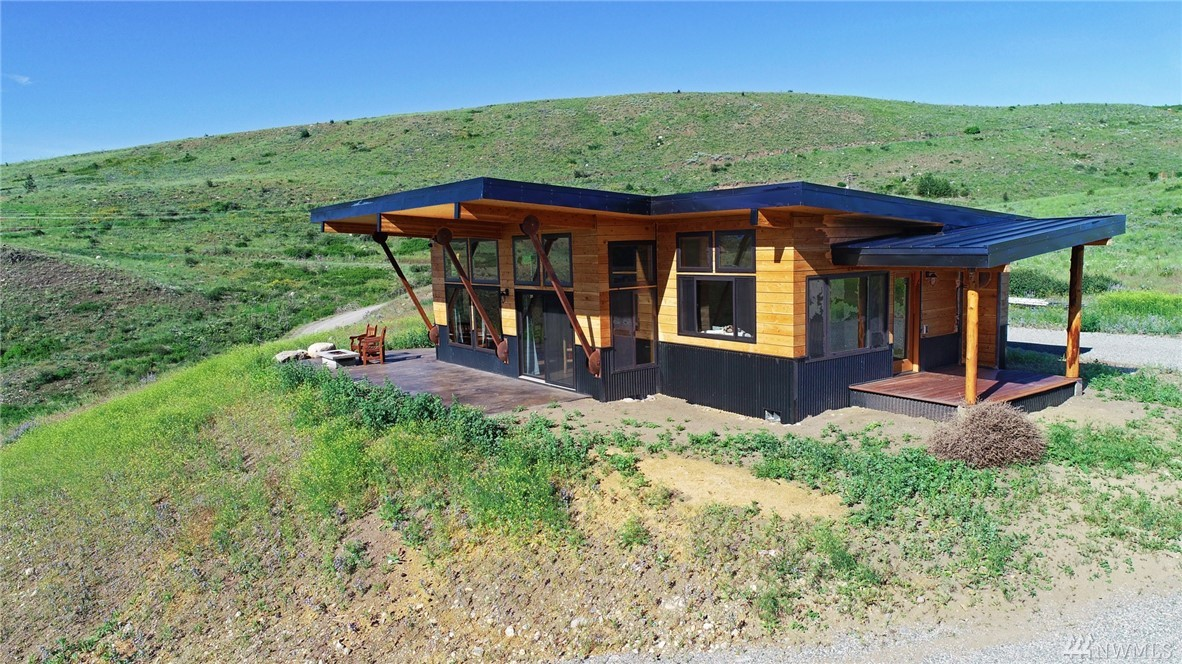 Spectacular river & mountain views! Fabulous new home on 3 acres between Twisp & Winthrop. Great room has huge windows & gas fireplace—perfect for gracious living & entertaining. You can enjoy sunshine on the patio, also the night sky as you relax around the outdoor gas fire pit. Great kitchen, master suite w/private deck, 2nd bedroom, 2nd bath, utility room, many custom features. New price includes detached garage with 3rd bedroom/office & 3rd bath to be finished in the same style as the house.