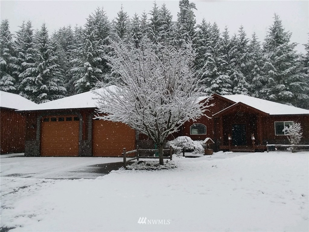 The best of both worlds! This beautiful custom rambler is on approx. 9.95 quiet, secluded & wooded acres yet close to downtown Eatonville.  Lynch Creek splits the parcel for a unique waterfront property. Radiant heated floors, air conditioning, heat pump and wood stove to cover all your seasons in comfort.  Large 16 x 32 shop with 12 x 12 door to accommodate your toys, RV or ?  Private driveway off cul-de-sac leads to black iron automated gate.  Fruit/nut trees on property, raised beds, large covered porch to sit and watch the abundant wildlife - Come make this yours!