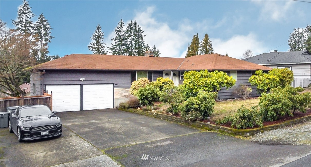 2856 sq ft, 4 bedroom University Place home located close to Chambers Bay. Excellent neighborhood, quiet street, convenient to shopping, parks and schools. Spacious living room with cozy gas fireplace. Updated kitchen with quartz countertops and stainless steel appliances. Hardwood floors. Huge covered deck for outside entertaining. Large fenced backyard with garden area and fruit trees. Highly sought after University Place School District. All appliances stay. Must see. Don't miss out on this opportunity!
