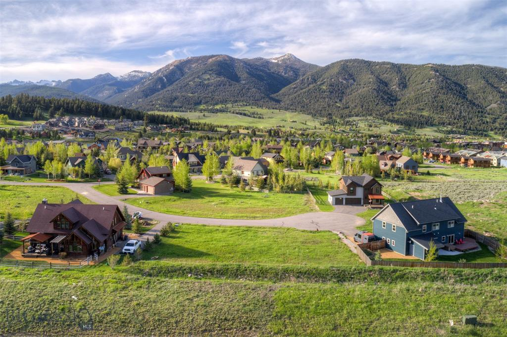 Sunny, Flat building lot with awesome views in all directions. Walking or biking distance to Big Sky Town Center.  Great family neighborhood.