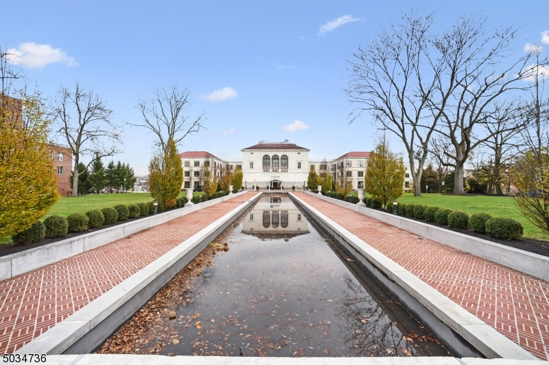 Luxury living in Morristown's premiere Vail Mansion.  Ultimate in convenience, located in the heart of downtown, close walk to major shops, restaurants and transportation. This spacious 2-bed unit features custom Hunter Douglas blinds, Bose sound system, crown molding, Viking appliances and hardwood floors throughout. The master bedroom leads to an expansive custom walk-in closet and stunning master bath complete with soaking tub & stall shower. Full size washer/dryer and ample storage.  Large windows provide natural light which compliments the warm color palette.  Underground parking and private entrance.  Enjoy concierge services, fitness center, billiards room and private storage area.  This incredible home provides all that Morristown has to offer, don t miss this opportunity!