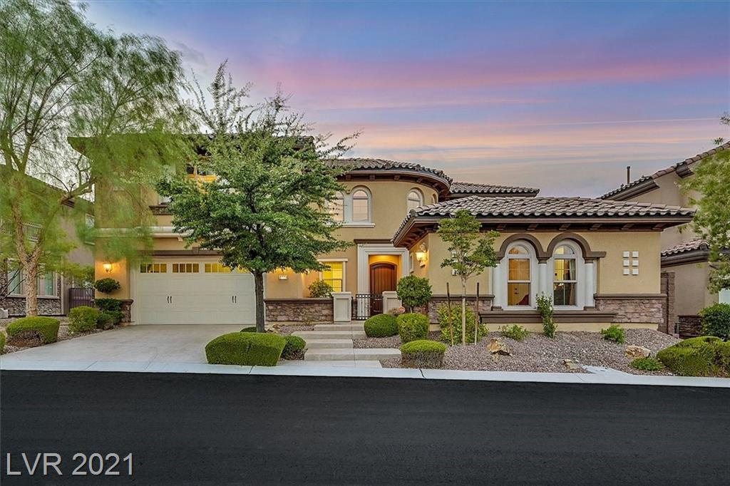 Former model with strip views. Over 4000 sq ft with casita, 4 beds, office, game room and a loft/library. A gourmet kitchen with granite counters, walk-in pantry, stainless steel monogram appliances including 2 convection ovens, 5 burner cooktop, built-in refrigerator, warming drawer, butlers pantry & wine fridge. The family room is open to the kitchen with cathedral ceiling, fireplace, & media niche. The grand master retreat is separate from the other bedrooms with his & hers walk-in closets, separate tub & shower, balcony with city views. The downstairs office has a full bathroom. The upstairs game room has panoramic views and full bathroom. The detached casita has a full bath and walk-in closet. Upgraded touches like stamped concrete, freshly painted exterior, dual staircases, crown molding, laundry room with sink, cabinets and more. Multiple outdoor areas including a paradise backyard with lush landscaping, pebble tech pool with fountains, 2 patio covers and gated front courtyard.