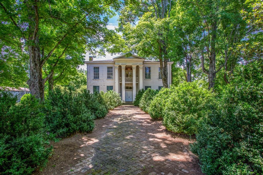 White Hall was a Greek Revival Home built in 1844 for Dr.Aaron White. This home is on the National Register of Historic Places. It was the Headquarters of Confederate General Earl Van Dorn in 1863.  Host to General Nathan Bedford Forrest and his troops.  The home now has a new road and sidewalks in front.