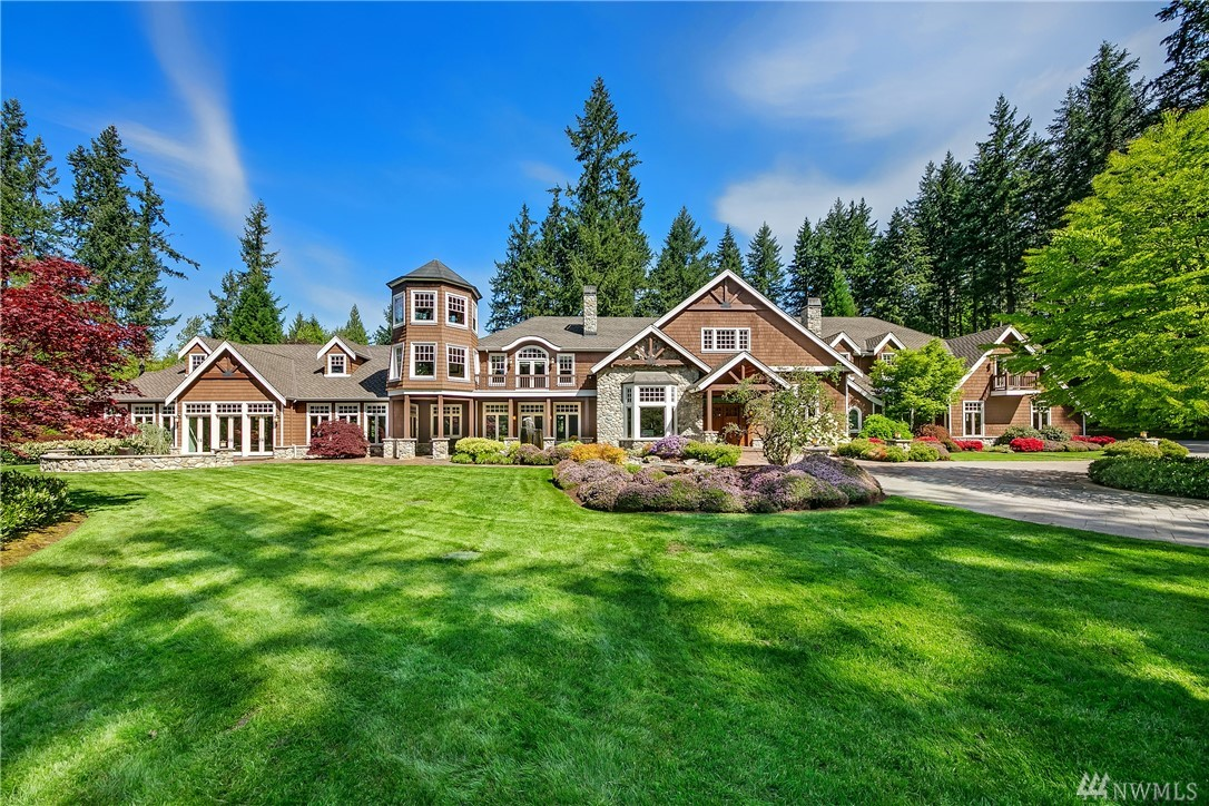 Just mins to MSFT, this 4.62 acre Union Hill estate sparks moments of appreciation from the subtle to the sensational. Your gated entries & private drive meander through prolific PNW manicured grounds. Sip whiskey snugged up to roaring hearths inside or out whilst relishing in life's grander pleasures: home theatre, party kitchen, shop, 8-car garage + auto gallery. Timber beams & natural stone exuding a profound permanence. A place where worries succumb to evergreen beauty & leisurely comforts.
