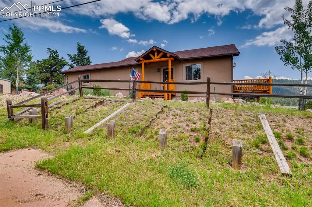 This home has some of the most spectacular views of Pike's Peak in the area! Charming Woodland Park ranch plan features 3 bedrooms (1 main / 2 conforming bsmt), 2 baths (1 main / 1 bsmt), living room with gas fireplace, kitchen w/breakfast bar and breakfast nook, finished basement and side load garage.  Enjoy the stunning views from the rear deck or from several indoor vantage points. Beautiful upgrades and finishes including hardwood floors, slab granite counters in the kitchen, stainless steel appliances, open floorplan, gorgeous natural wood doors & cabinets and gutters have French drains.  Located on a spacious .24 acre lot with landscaping,  natural vegetation and trees.  The finished walk-out basement is perfect for guests or that teen wanting their own space.  The energy efficient furnace, ceiling fan and gas fireplace keep this home comfortable all year long. Pride of ownership shines throughout.  This home offers a peaceful oasis while still being close to dining, shopping, entertainment and other amenities.  No HOA.  Don't miss your opportunity.  Welcome Home!