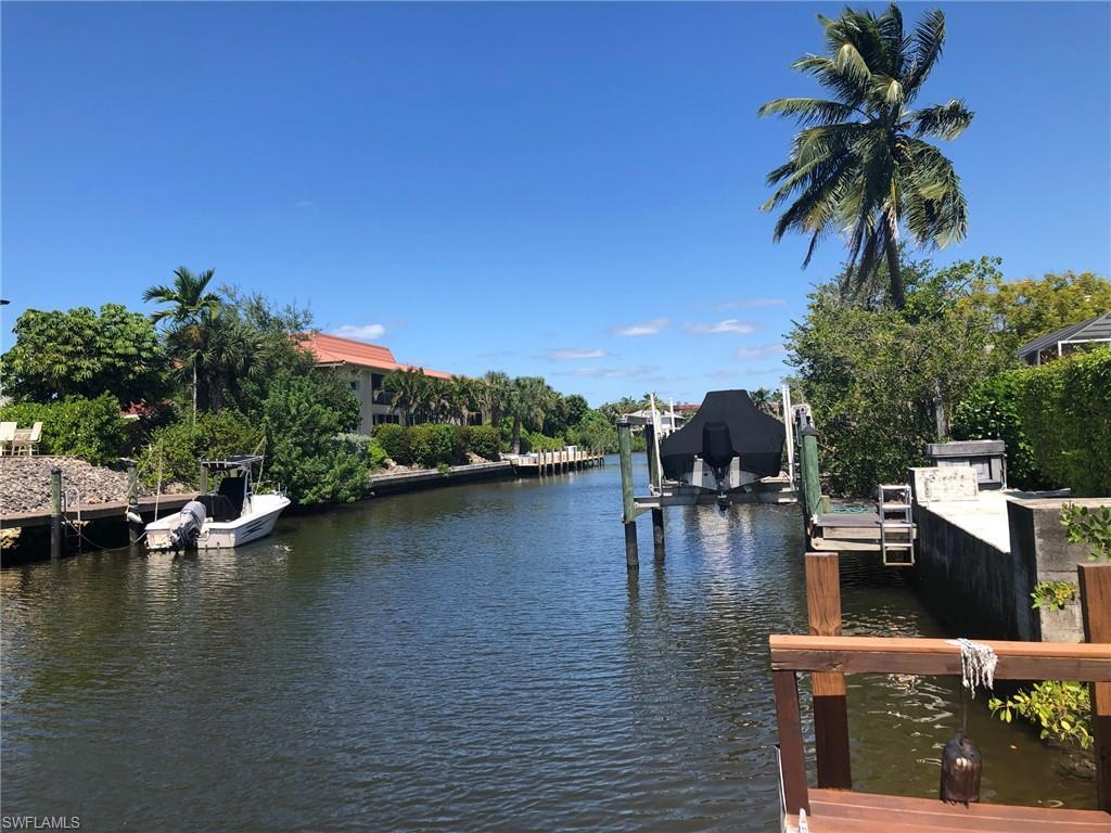 ATTN BOATERS!  Great Location, Single family pool home just minutes from downtown and the beach! Direct access boating to the Gulf of Mexico. Come and see this large 3 bed 2 bath home for yourself. Nice split bedroom floorplan.  Huge pool, U - shape driveway. 2 car garage. This home has everything you need to live the Florida Lifestyle. Walk or bike to 5th Ave shops, restaurants and beach.