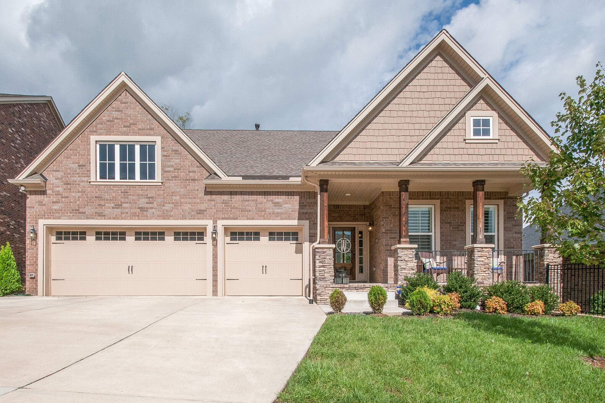 WOW!!! 6 beds, 4 baths, HUGE bonus room,  coffered ceilings, built in bookcases, recessed lights galore, HARDWOODS throughout house, tile bathrooms, amazing plantation shutters,kitchen to die for, 2 beds down, 4 beds up, 3 car garage, stone fireplace, large covered deck,